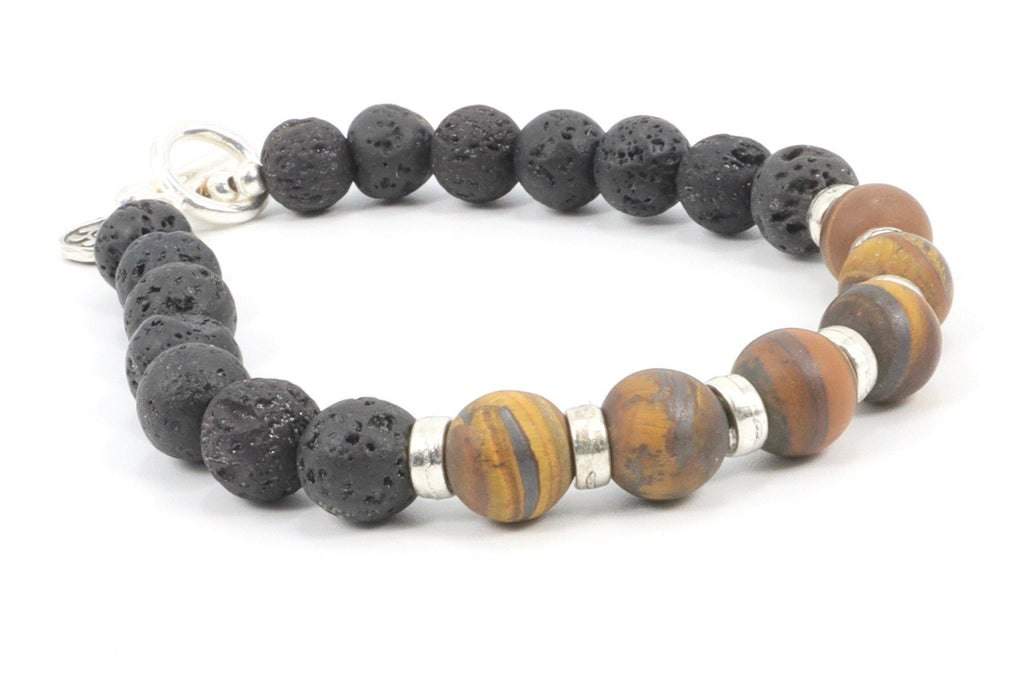 This is a man's tiger eye bracelet. It is beaded with lava stone, made on a sturdy wire, and closes with a toggle clasp. The mate brown tiger eye makes this bracelet very attractive for men who prefer an understated look.