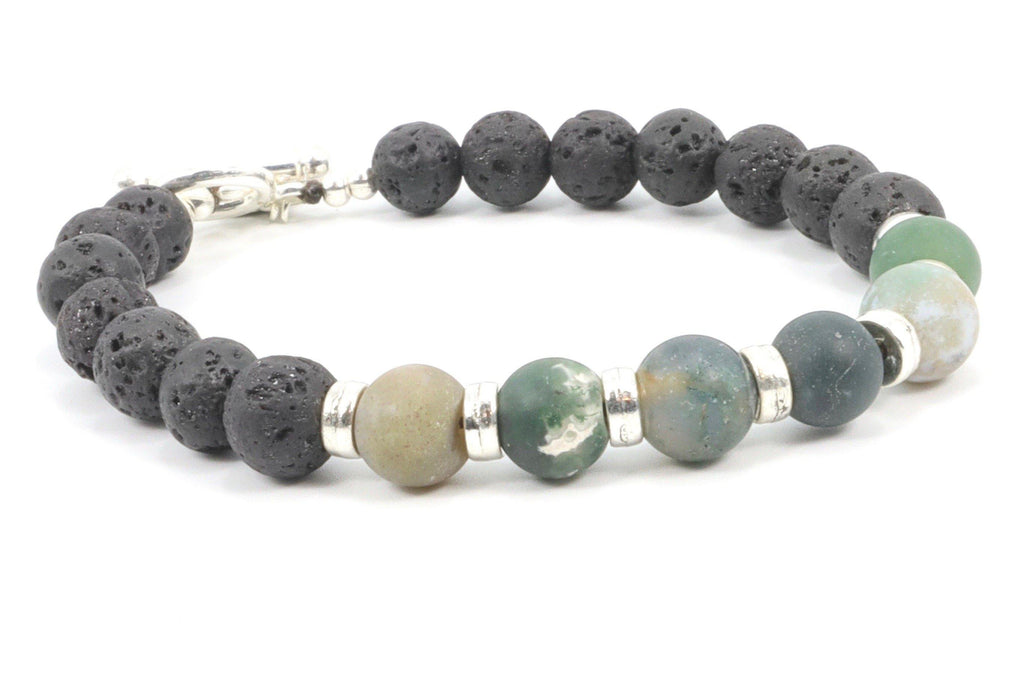 This is a man's Indian Agate bracelet. It is beaded with lava stone, made on a sturdy wire, and closes with a toggle clasp. The mate green color makes this bracelet very attractive for men who prefer an understated look.