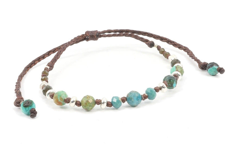 This gemstone bracelet is made with African turquoise stone, knotted on a waxed cotton cord. Turquoise promotes self-realization and assists in creative problem-solving. The combination of colors marbled in the African turquoise with its beautiful hues of browns, and turquoises, is perfect to help you feel grounded on earth and in contact with nature. This gemstone bracelet is perfect for stacking with other bracelets, it's color pallet will give you plenty of options to combine with leather boots, jeans, a