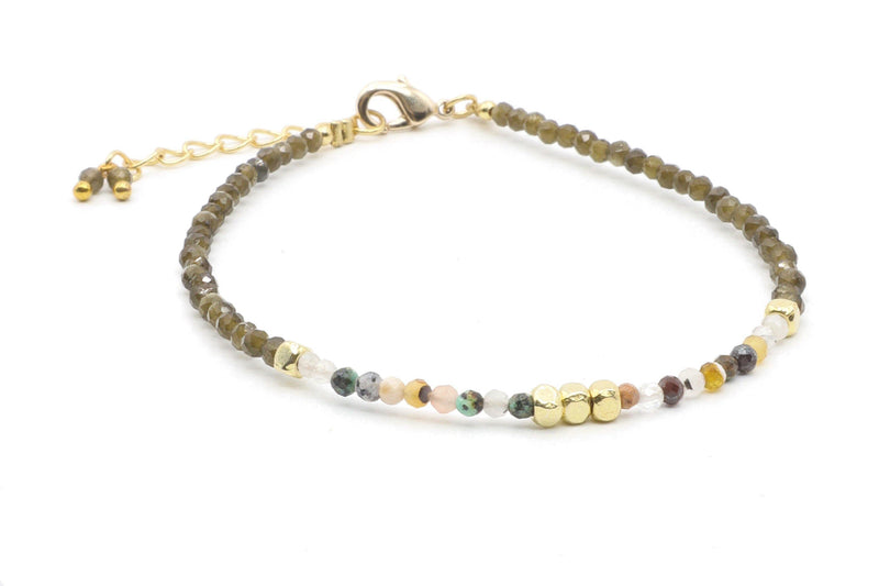 This is an obsidian and tourmaline beaded bracelet, with 18k gold anti-tarnish plated beads. Obsidian is considered to be a shield against negativity, an ally to draw out tension, stress and clear the mind. The healing properties of tourmaline are known for balancing, enhancing, and removing blockages of energy. Tourmaline is wonderful for happiness and serenity. It is the perfect combination.