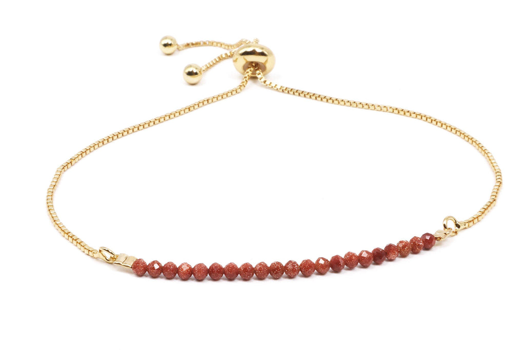 This is a sandstone bracelet on an 18k gold plated slide chain. This gemstone bracelet is dainty, minimalist, and understated.