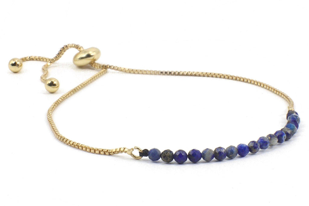 This is a sodalite bracelet, beaded on an 18K, gold plated, slide chain. COLOR PALLET: People with Deep Autumn coloring. This is someone with dark olive, or dark brown eyes or dark auburn or dark brown hair and pink or olive skin. The intense color like the deep blue will not overpower you, it will compliment your deep natural colors. Wear it with your tight blue jeans, your honey-colored leather sandals, and your flowy white cotton peasant top and you will look like a star!