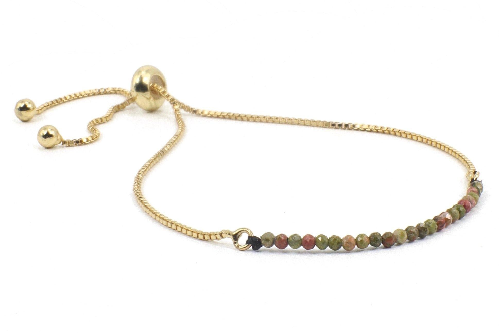 This is a unikite gemstone bracelet. This dainty gemstone bracelet is beaded on an 18K gold plated slide chain.  COLOR PALLET: These colors look great on people with Deep Autumn colors like dark olive, or dark brown eyes, with dark brown or dark auburn hair.