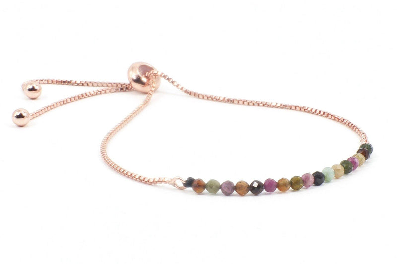 DESCRIPTION: This is a tourmaline gemstone bracelet on an 18k, gold plated, anti-tarnish, slide chain.  COLOR PALLET: The deep purple and pink colors will look especially great on people with warm autumn coloring. This means burgundy or strawberry blond hair, warm eyes, like green or amber.