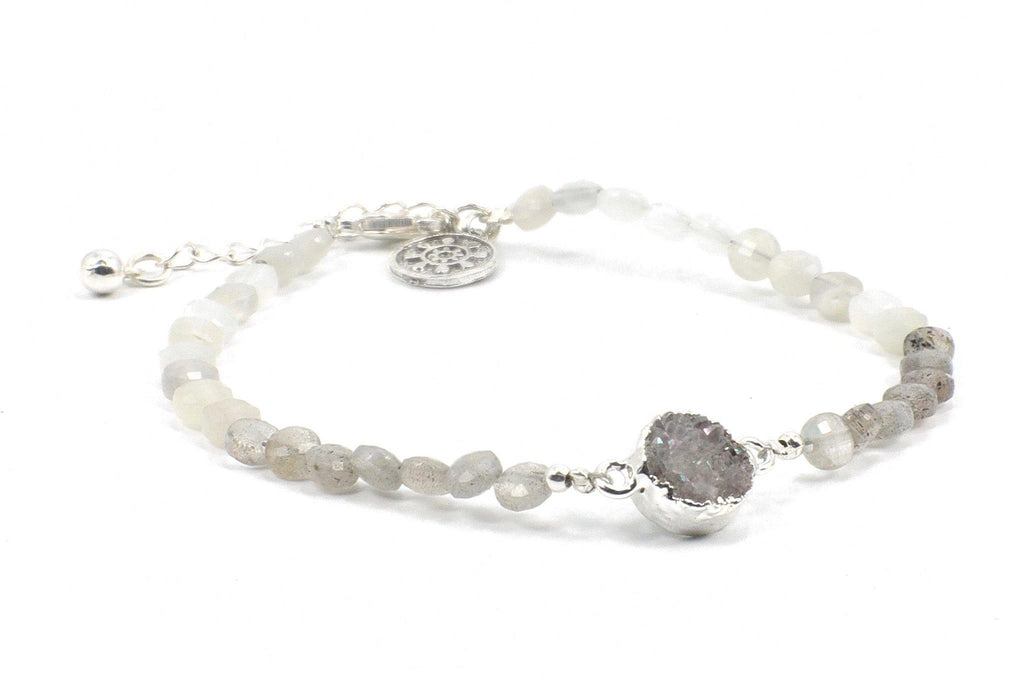 This is an elegant moonstone and labradorite gemstone bracelet, with a druzy quartz pendant.