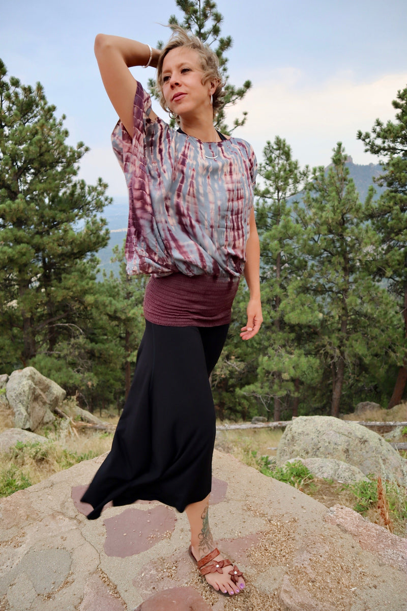 The Wide Leg Dance Pants has a tiered, elastic, scrunch top with trapeze, flowing legs. They are exhilarating, dancing pants with a beautiful flow style. The capri, low-rise, asymmetric style offers a flattering, sexy look with any style shirt.