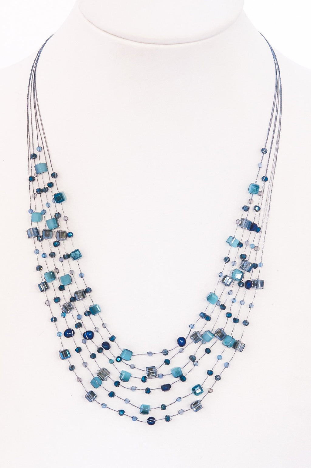 This is a layered bib necklace made with silk thread and hand-tied crystals both round and square. It's sexy, simple and sophisticated.