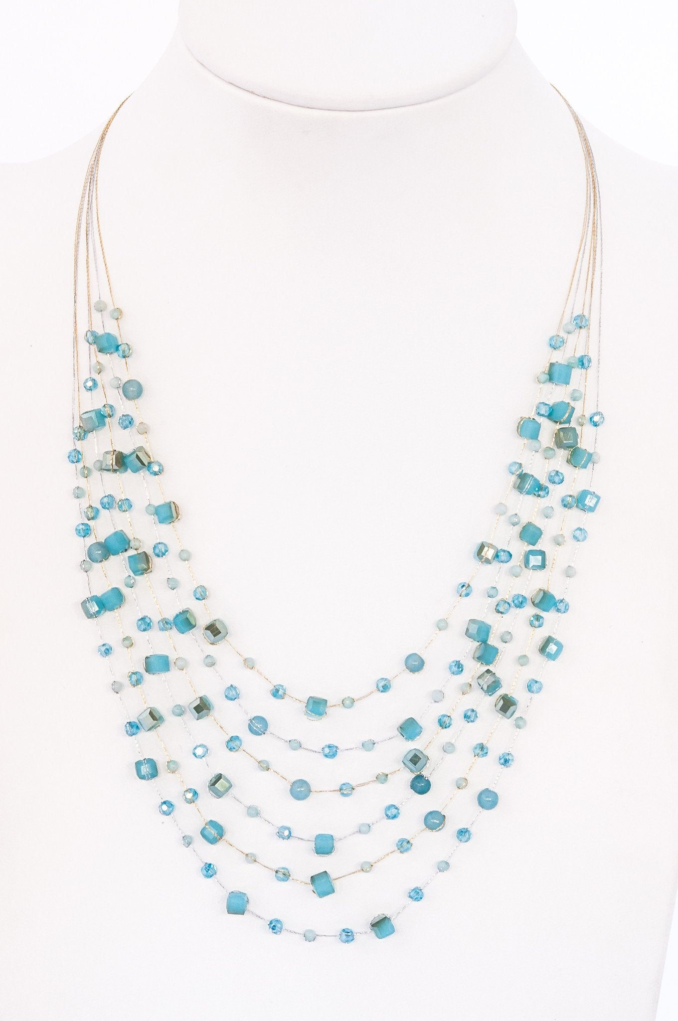 This is a layered bib necklace made with silk thread and hand-tied crystals both round and square. It's sexy, simple, and sophisticated.