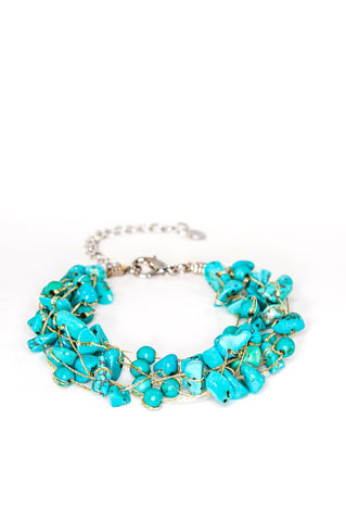 Turquoise natural gemstone bracelet with a sterling silver clasp strung on silk thread.  This is handmade and fair trade.