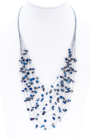 Made with Lapis Lazuli stone, the Athena design is a fashionable bib style necklace that makes a great statement piece.  It is hand strung with semi precious gemstones on silk thread.
