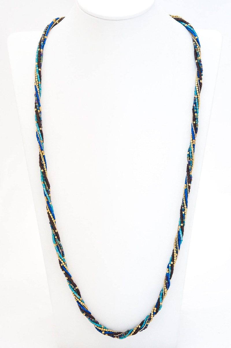 "This is a handmade fair trade beaded gemstone necklace intertwined with a silver / gold chain and a metal button. It can be worn as a long necklace 32"" or doubled as a 16"" necklace."