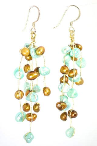 filosophy jewelry store. Pearl earrings. Brown and turquoise pearl earrings.