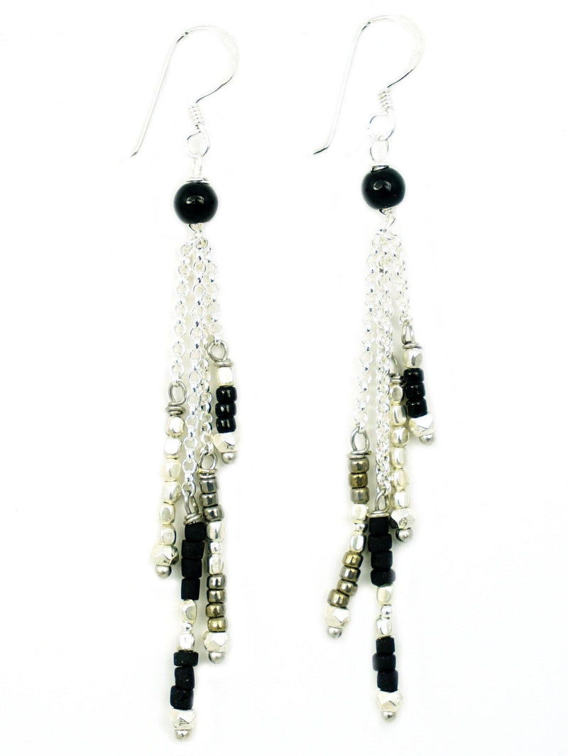 These are handmade, fair trade earrings made with gemstones and silver beads on a silver chain. These long drop style earrings are an elegant and sophisticated style. These dangly, layered gemstone earrings flow along your face and peak through your hair shaping your face flawlessly.