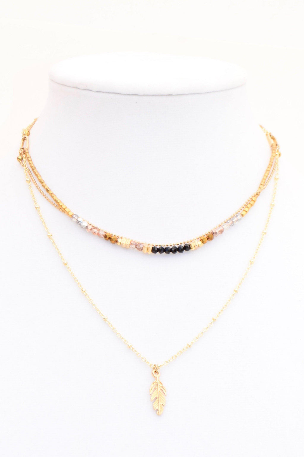 This is a handmade fairtrade beaded necklace named Faye. This beautiful gemstone, gold, and gold feather charmed necklace is elegant but casual enough to wear with your day-to-day outfits. It has a waterfall of earthy colors, that will make your outfit look spectacular! It is a layered style that is lightweight and accentuates your gorgeous necklines.