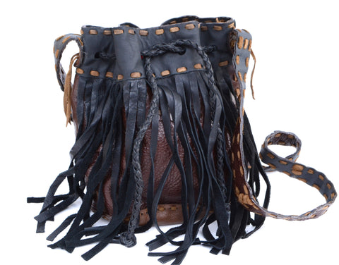 This is a boho bag is a handmade leather bag with leather fringe strings