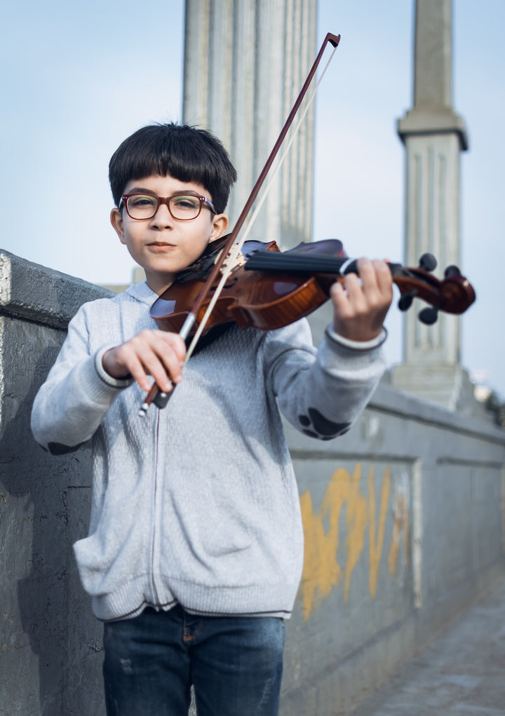 Child beginning violin lessons