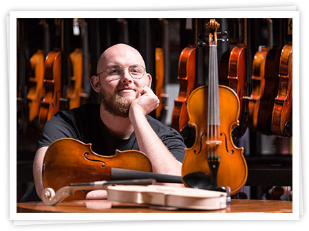 Man sitting with violins