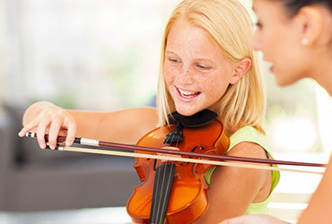 Learning to play the violin at a young age