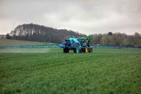 grass-fed-beef-spraying-chemicals-pesticides-on-beef-farm