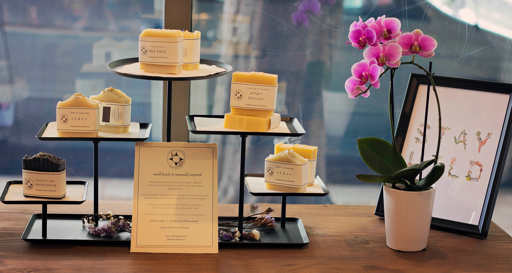An in-store display of Botanical Soaps, made in small batches and inspired by the season, available at Apotheka Herbal.