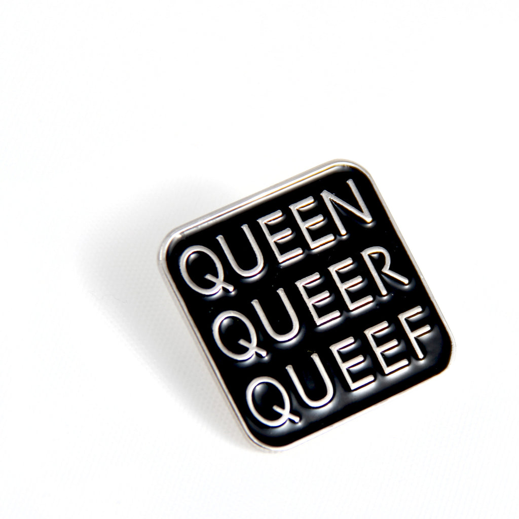 Close up of Q-word pin, Says Queen, Queer, Queef