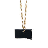 Black leather South Dakota shaped necklace, close up