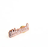 Close up of Tildasexual Pin, rose color pin with white lettering