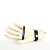 Palm view of black leather hand harness on mannequin