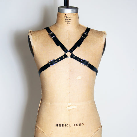 Black leather harness that makes an x across your chest