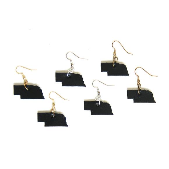 Group of black Nebraska shaped leather earrings