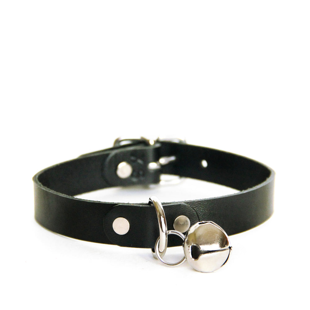 Front view of a black leather choker with silver hardware and silver jingle bell on a white background.