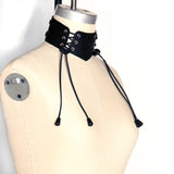 Dressform at an angle wearing a Laced Front Choker. Angle highlights the silver grommets and bungee cord laces.