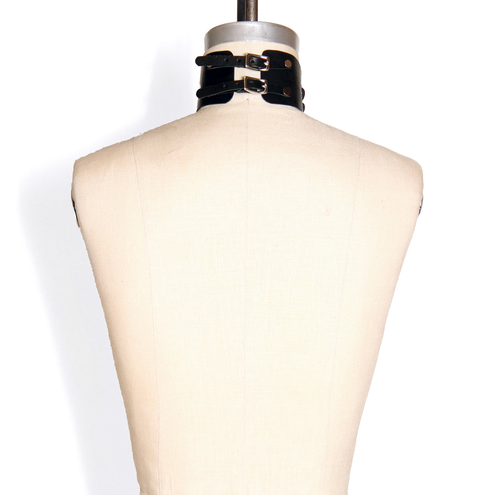 Back of dressform wearing a Laced Front Choker. The double straps in the back are shown with their small buckles.
