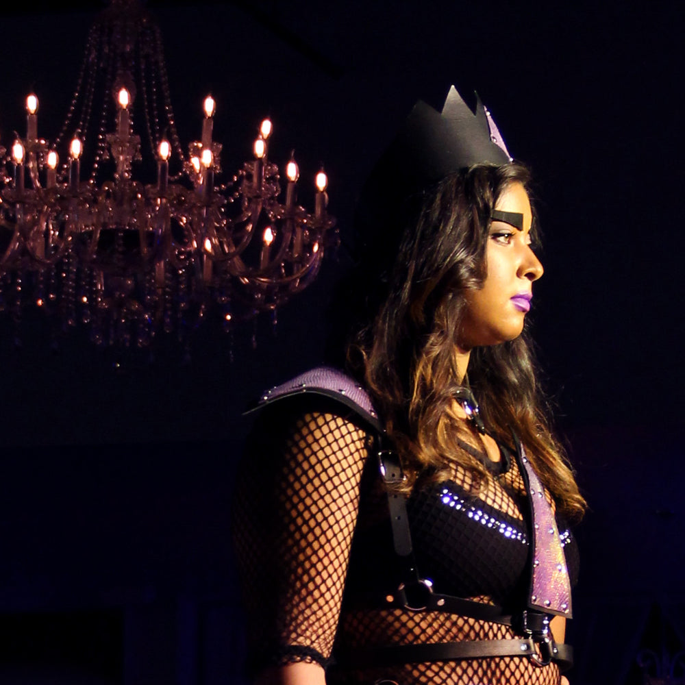 Model wearing black leather crown (tall) with mermaid leather triangle