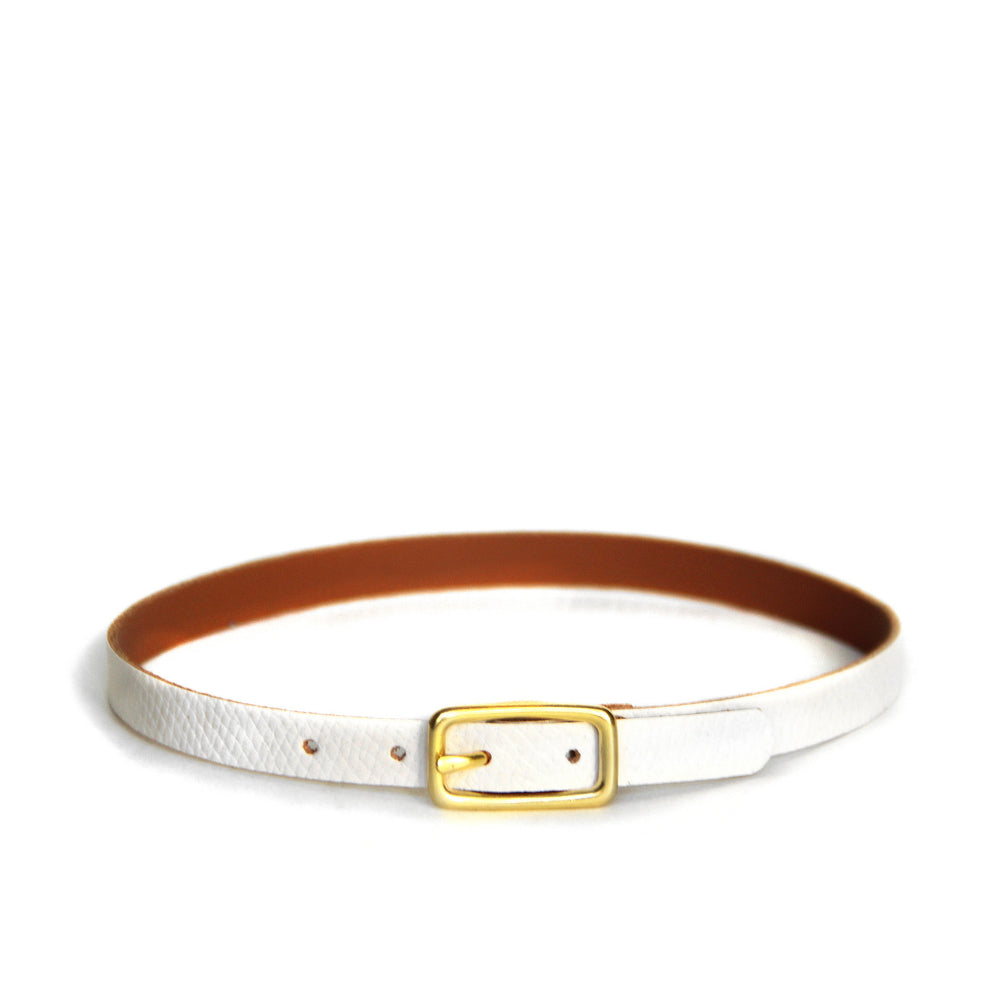 White leather choker with brass hardware, front view