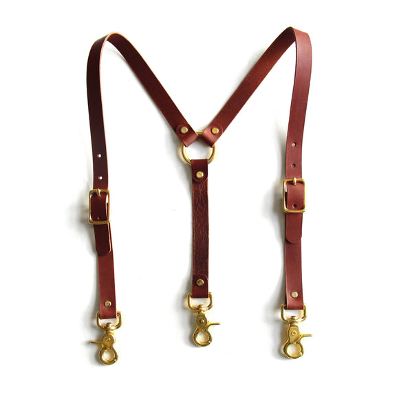 Chestnut brown leather high-waisted suspenders, with swivel trigger clips and brass hardware