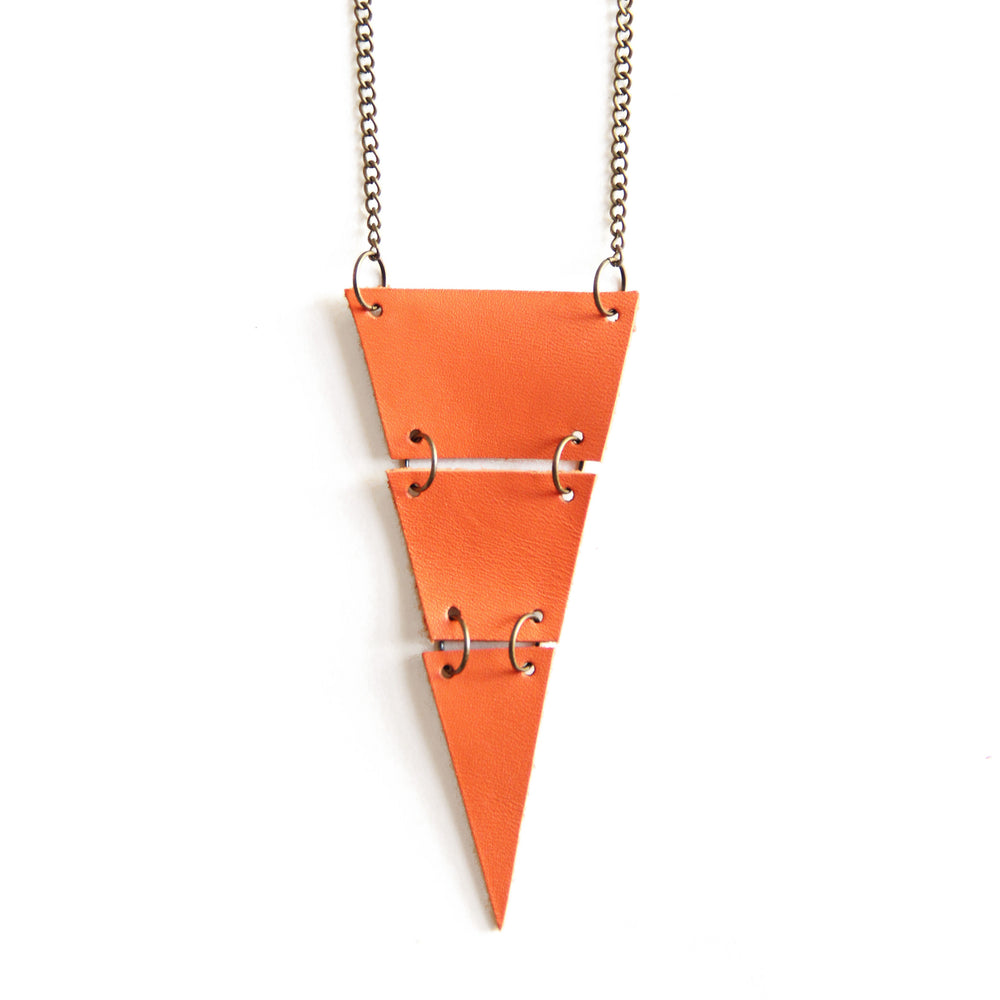 Orange leather triangle necklace, cut into 3 sections, close up view