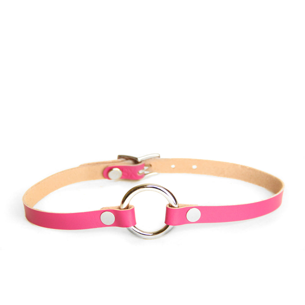 Hot pink leather collar with a silver o-ring at the front. Backside of leather is tan.