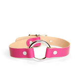 Leather collar made from hot pink leather paired with silver o-ring and hardware. Backside of leather is tan.