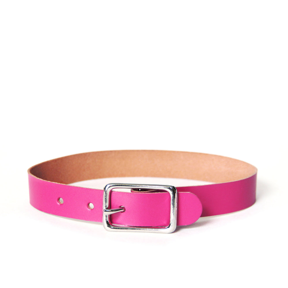 Basic buckle choker created out of hot magenta leather. Leather is smooth and paired with a silver buckle.