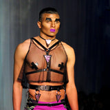 Model wearing black half suspender harness with mermaid triangle.