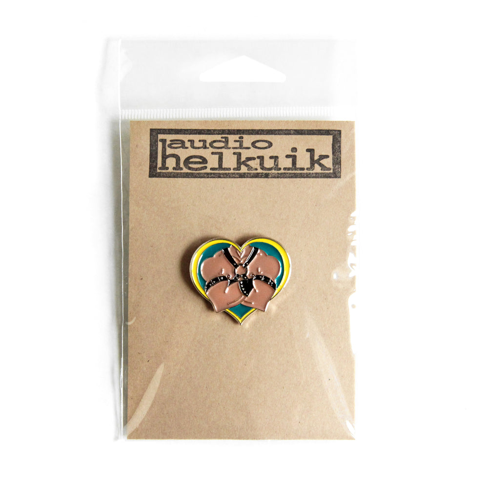 Enamel leather daddy pin shown in branded packaging.