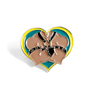 Close up of Leather Daddy pin, muscle man with chest harness on a heart shaped pin