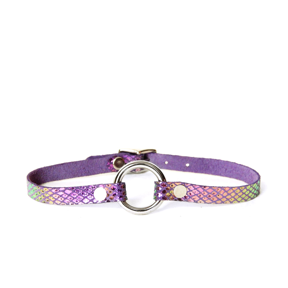 Purple leather choker with a silver o-ring. Leather is covered in iridescent scales that shine teal, yellow and magenta in the light.