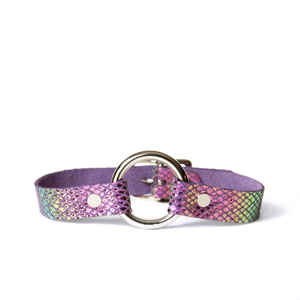 Purple choker with silver o-ring. Leather is covered in iridescent scales that shine teal, yellow and magenta in the light.