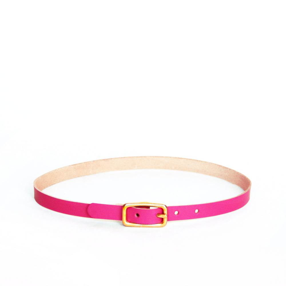 Slim leather choker made from hot magenta leather. Choker has a small brass buckle.