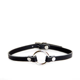 Classic black leather collar with silver o-ring hardware. Shown on a white background.