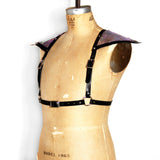 Black leather half suspender harness with silver hardware and mermaid leather triangle sholders, angled front view