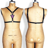 suspender harness with mermaid leather in front.