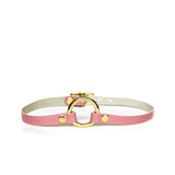 A mini o-ring choker made from a smooth rose pink leather. This leather collar has a brass o-ring.